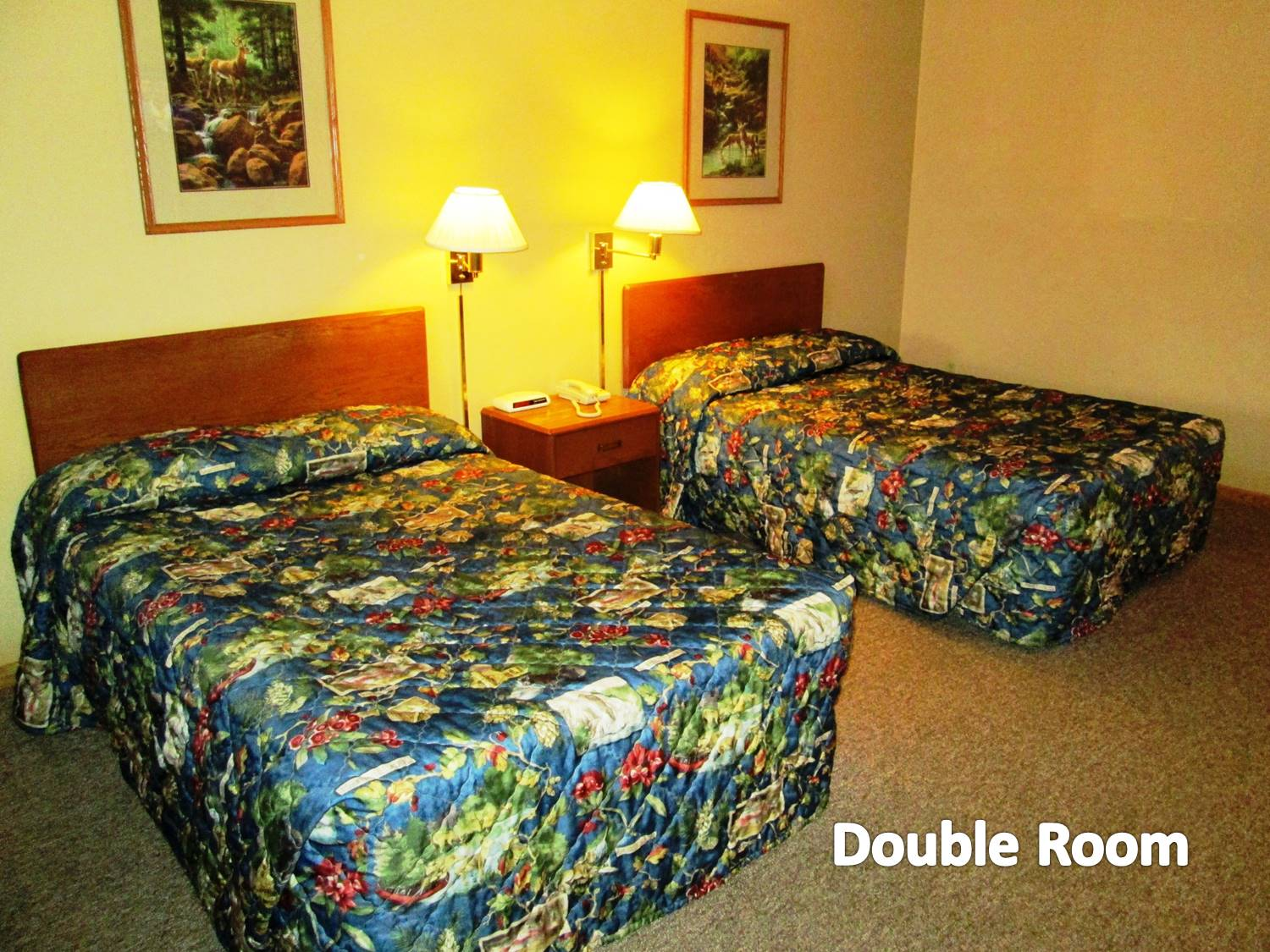 Room with two full-size beds and appropriate furnishings.